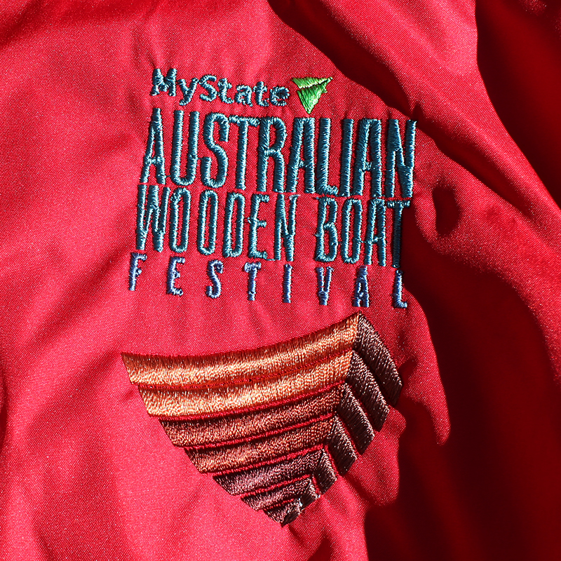 Red Wind Jacket Logo